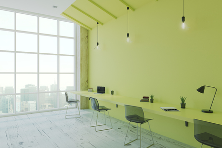 Modern eco style office room with green desk and wall, wooden floor and floor-to-ceiling window. 3D render Stock Photo