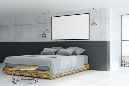 big blank picture frame on concrete wall above bed with grey blanket in concrete style room. 3D render Banque d'images - 103849606