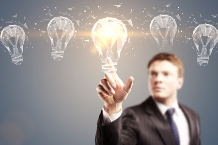 idea concept with 3d light bulbs illustration in the air and businessman touching luminious one at abstract grey background