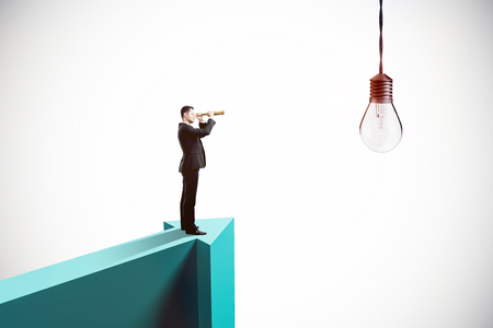 Side view of young businessman on arrow looking at lamp with binoculars. Idea concept