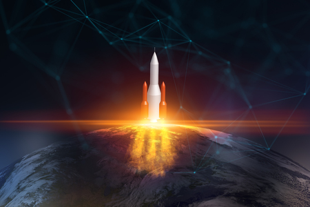 Abstract image of launching rocket on blurry space background with globe. Startup and future concept.