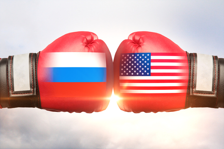 Red boxing gloves with country flags against each other on cloudy sky background. Russia vs USA concept. 3D Rendering