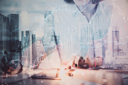 Hands typing on laptop. Business and Financial concept. Double exposure of stock market charts. Stok Fotoğraf - 121854981