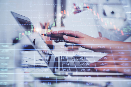 Hands typing on laptop. Business and Financial concept. Double exposure of stock market charts. Stok Fotoğraf - 121855853