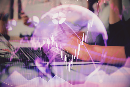 Hands typing on laptop. Business and Financial concept. Double exposure of stock market charts. Stock fotó