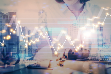 Hands typing on laptop. Business and Financial concept. Double exposure of stock market charts. Stock Photo - 121855997