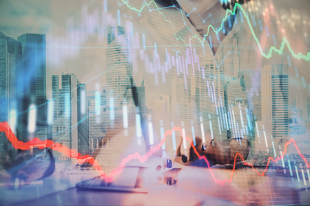 Hands typing on laptop. Business and Financial concept. Double exposure of stock market charts. Stok Fotoğraf - 121856001