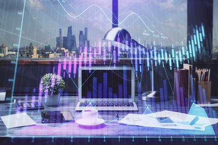 Double exposure of stock market chart and office desktop on background. financial strategy concept.
