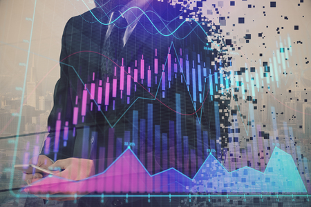 Double exposure of businessman using cell phone and stock market charts. Financial concept.