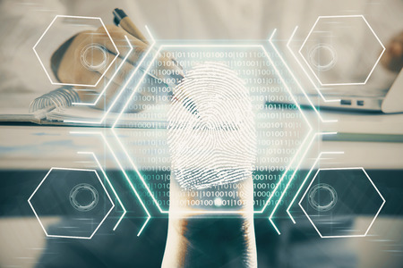 Blue fingerprint hologram over womans hands taking notes background. Concept of protection. Double exposure