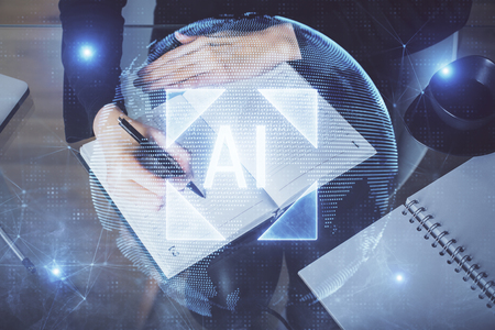 Double exposure of writing hands on background with data solution hologram on front. Technology concept. TOP view. Banco de Imagens