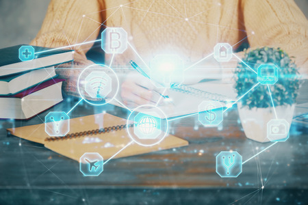 Social network theme hologram over womans hands writing background. Concept of international people connect. Double exposure