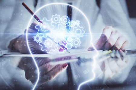 Multi exposure of womans writing hand on background with brain hud. Concept of learning. Reklamní fotografie