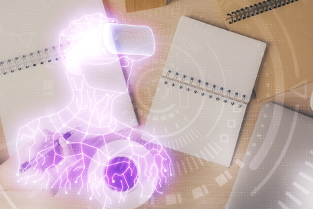 AR hologram over hands taking notes background. Concept of augmented reality. Double exposure Stockfoto