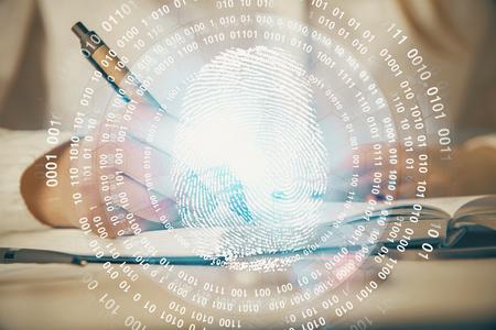 Blue fingerprint hologram over woman's hands taking notes background. Concept of protection. Double exposure Banco de Imagens - 123195163