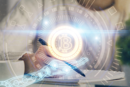 Cryptocurrency hologram over hands taking notes background. Concept of blockchain. Multi exposure Banco de Imagens - 123192507