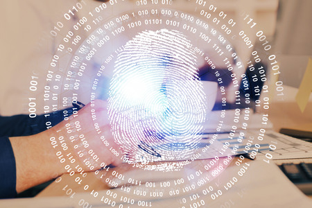 Concept of the future of security and password control through advanced technology. Fingerprint scan provides safe access with biometrics identification. Multi exposure. Stock Photo