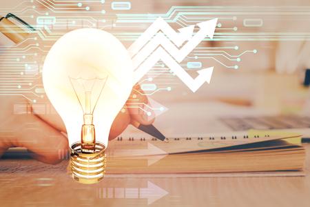 Innovative your business. Idea concept icon on writing mans hand background. Multi exposure. Stock Photo