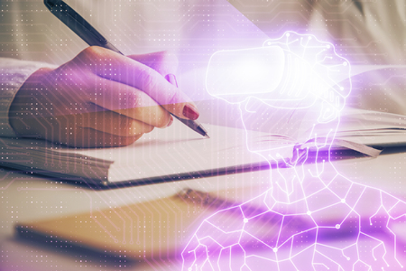 AR hologram over hands taking notes background. Concept of augmented reality. Double exposure Stock Photo