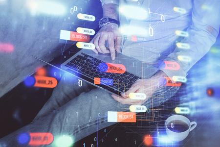 Multi exposure of data internet theme hologram with man working on computer Zdjęcie Seryjne