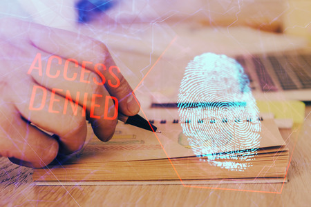Concept of the future of security and password control through advanced technology. Fingerprint scan provides safe access with biometrics identification. Multi exposure. Banco de Imagens