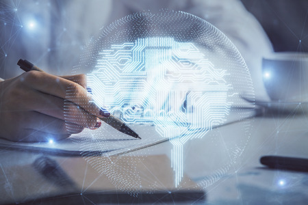 Double exposure of womans writing hand on background with brain hologram. Concept of brainstorming.