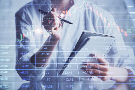 Financial chart drawn over hands taking notes background. Concept of research. Multi exposure Stock Photo