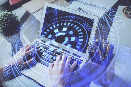 Multi exposure of technology hologram with man working on computer background. Concept of big data. Stock Photo