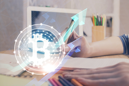Cryptocurrency hologram, bitcoin, ico theme over hands taking notes