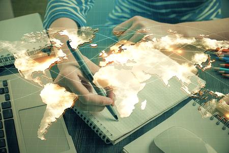 International business hud over womans hands writing