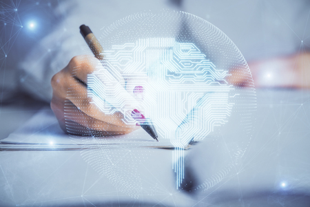 Double exposure of womans writing hand on  with brain hologram. Concept of brainstorming. Stock Photo