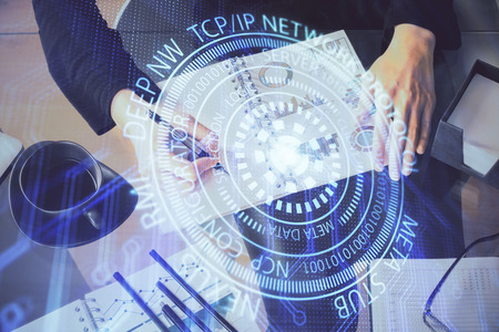 Multi exposure of womans writing hand on  with data technology hud. Big data concept. Stock Photo