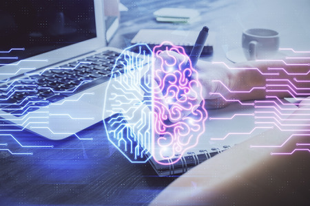 Multi exposure of writing hand on  with brain hologram. Concept of learning.