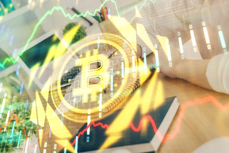Cryptocurrency hologram over hands taking notes