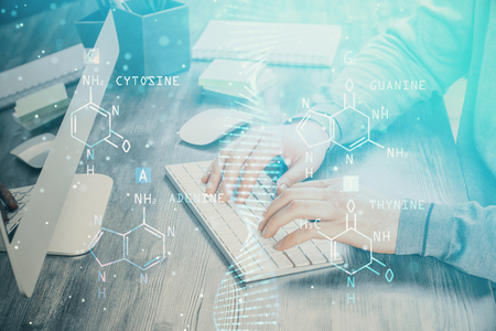DNA hologram with businessman working on computer