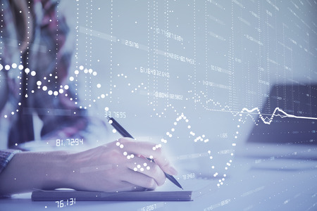 Double exposure of womans writing hand on background with data technology hud. Big data concept.