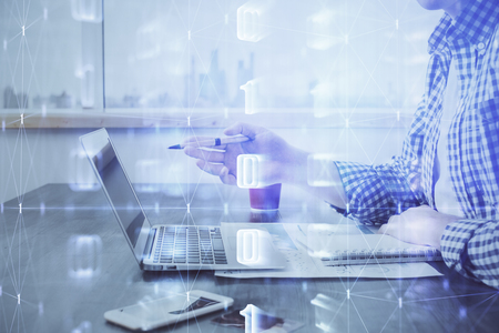 Businessman working on Laptop with technology theme drawing. Concept of big data. Double exposure.