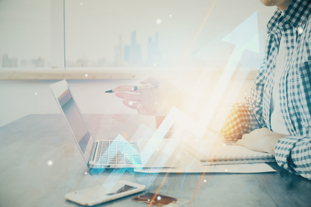 Growing arrows with businessman working on computer on background. Success concept. Double exposure. Stock Photo