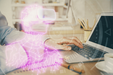 AR hologram with man working on computer on background. Augmented reality concept. Double exposure. Stock Photo