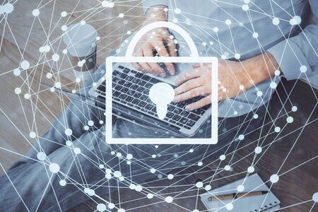 Multi exposure of lock icon with man working on computer on background. Concept of network protection. Stock Photo