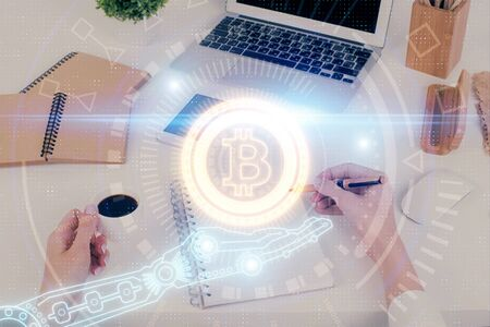 Cryptocurrency hologram over woman's hands writing background. Concept of blockchain. Multi exposure Zdjęcie Seryjne - 124969019