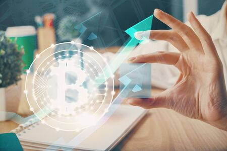 Cryptocurrency hologram over hands taking notes background. Concept of blockchain. Multi exposure Zdjęcie Seryjne