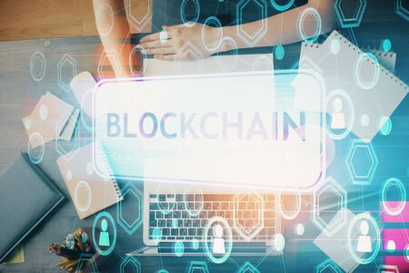 Cryptocurrency hologram over hands taking notes background. Concept of blockchain. Multi exposure Zdjęcie Seryjne - 124969479