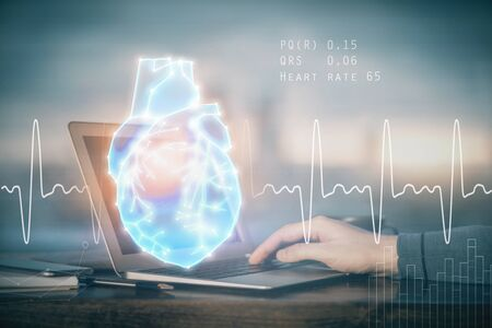 Heart drawing with man working on computer on background. Medical concept. Double exposure.