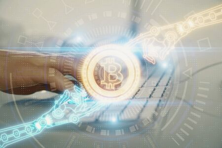 Crypto currency theme hologram with businessman working on computer on background. Concept of blockchain. Double exposure.