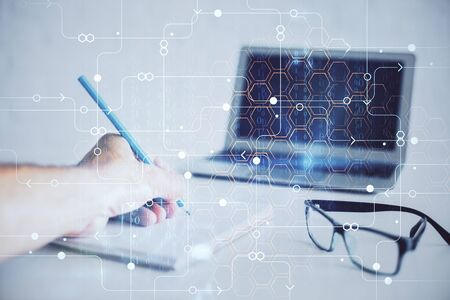 Writing man with technology icons. . Double exposure. Network and data concept.