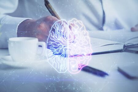 Brain multi exposure icon with man hands background. Concept of learning. Stock Photo