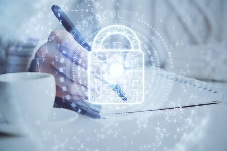 Double exposure of womans hands writing with lock icon. Concept of security and protection of data
