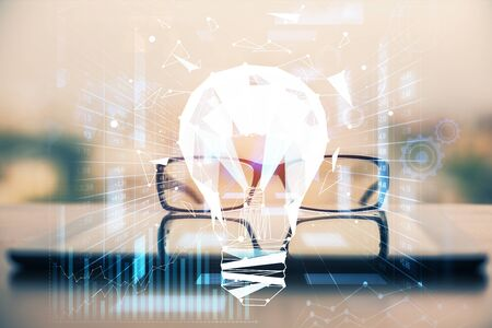 Bulb drawing with glasses on the table background. Idea concept. Double exposure.