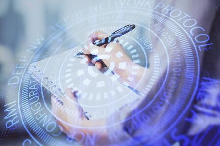 Multi exposure of womans writing hand on background with data technology hud. Concept of innovation.